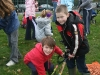 Children planting bulbs in the park